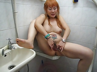 Mature asian piss